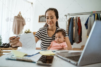 Dropshipping business owner working in her office. working mother
