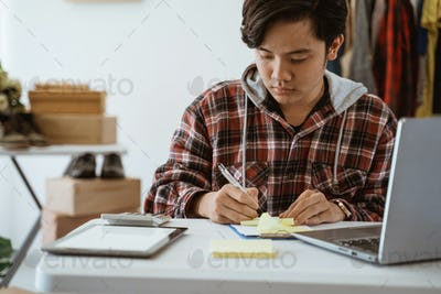 Dropshipping business owner working in his office