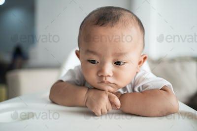 thoughtful cute asian boy
