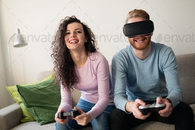 Couple enjoying VR and playing games