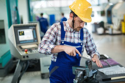 Metal industry factory worker working on metal parts