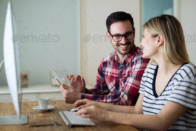 Couple with ideas working from home