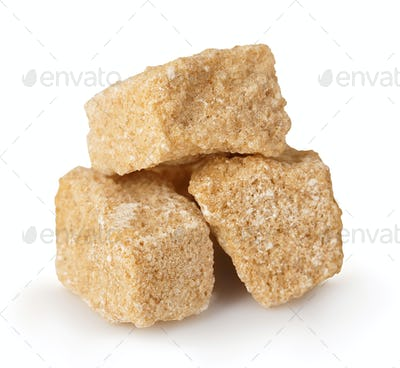 Brown sugar close-up isolated on white background.