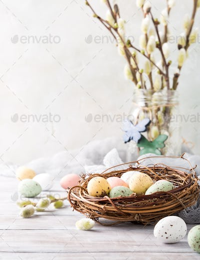 Easter composition of quail eggs in the nest