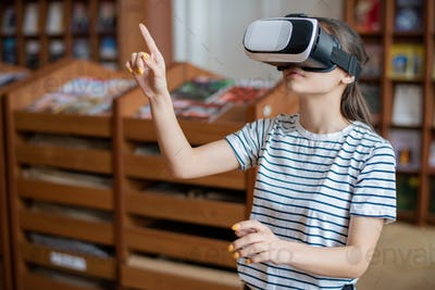 Clever contemporary college student with vr headset pointing at virtual display
