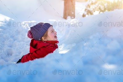 Happy child in the snow