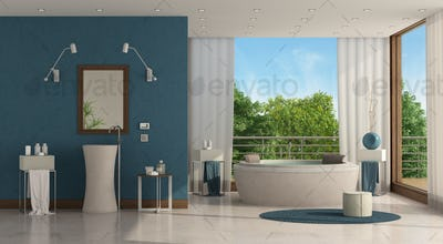 Luxury bathroom with round bathtub and washbasin