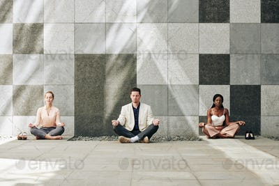 Business people in lotus position