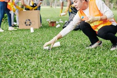 Volunteer picking up litter