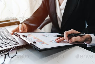 Business people working on Desk office with marketing graph statistics analysis