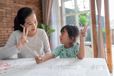 mum and kid learning maths together at home