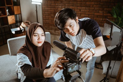 young couple vlogger preparing camera to create their vlog content