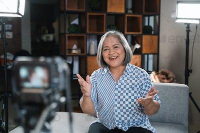 Confident women entrepreneurs recording vlog