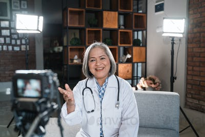 woman doctor recording video for his blog