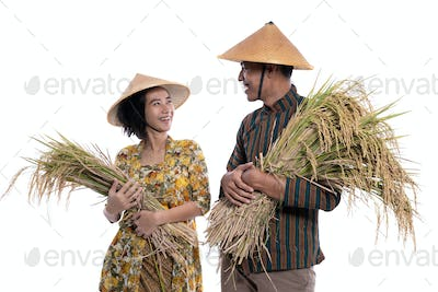happy young couple farmer smiling to each other