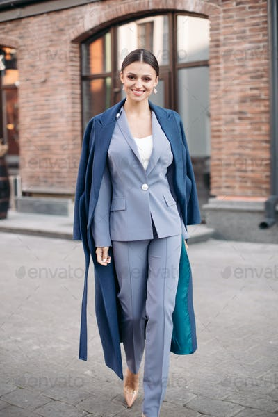 Beautiful stylish lady in blue coat and heels