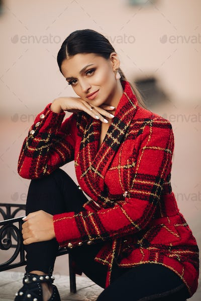 Beautiful young adult brunette in stylish look