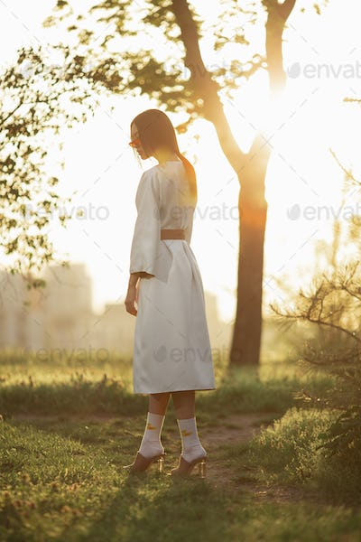 Asian woman in traditional japanese kimono outdoors