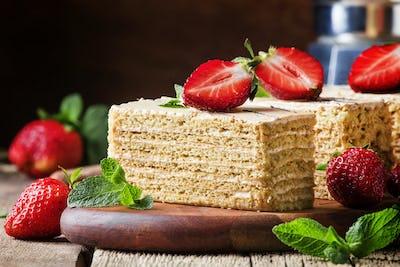 honey cake decorated with strawberries