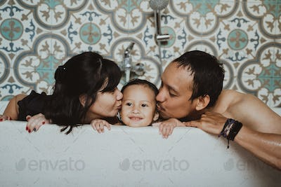 having fun together young family when playing on the bathtub