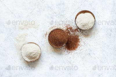 Raw teff grain and teff flour in a wooden bowls