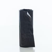 Garbage bags roll isolated against white background,