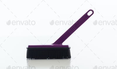 Cleaning brush purple color isolated against white background.