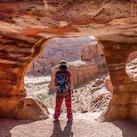 Traveler Woman Posing at the Entrance of a Tomb in Petra, Jordan