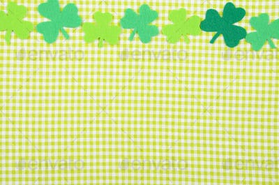 Flat lay Happy St. Patrick's background mockup of handmade felt shamrock clover leaves