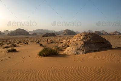 Sand Dunes and Sandstone Cliffs in Wadi Rum Desert , Jordan