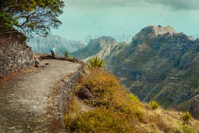 Santo Antao Island Cape Verde. Female tourist enjoying view to Caculi valley on hike from Corda