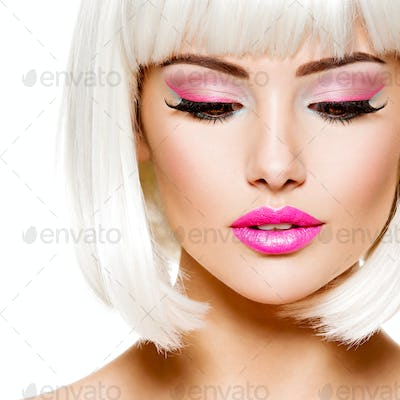 Face of a fashion model with bright pink make-up and white hairs