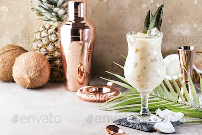 Pina Colada Cocktail on sand beige background