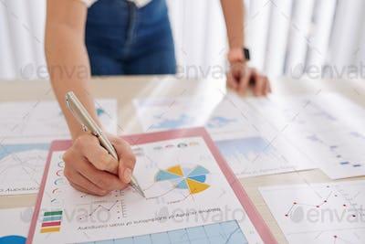 Businesswoman analyzing reports