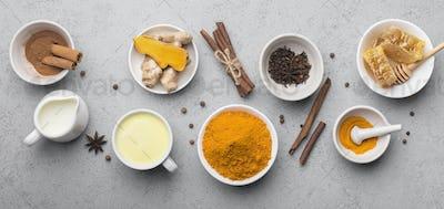 Fresh ingredients for turmeric curcuma healthy drink on gray