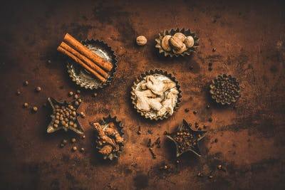 Flat-lay of Turkish spice Yedi Bahar mix over rusty background