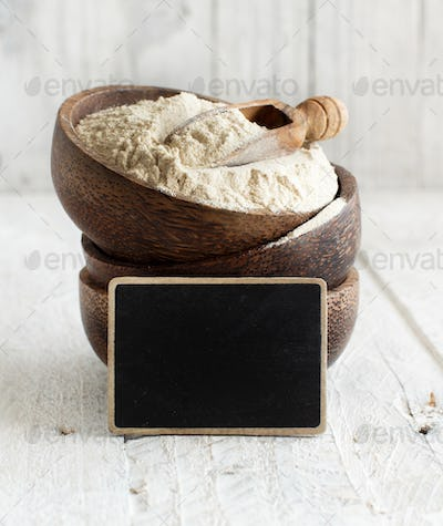 Teff flour in a bowl and small chalkboard