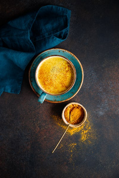 Top down view of turmeric latte cup