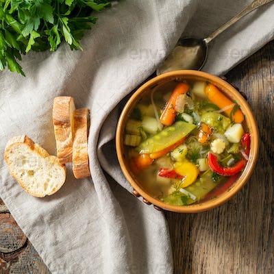 Bright spring vegetable dietary vegetarian soup. Top view, brown