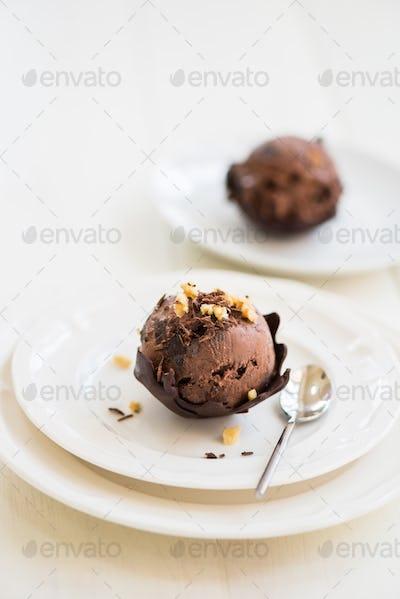 Chocolate Ice Cream Scoop is laying on Chocolate Homemade Bow