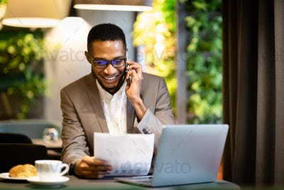 Portrait of black businessman making phone call