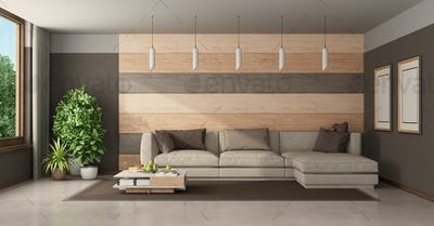 Modern living room with sofa against wooden paneling
