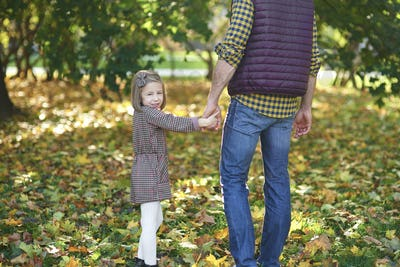 Rear view of father and daughter during autumn walk