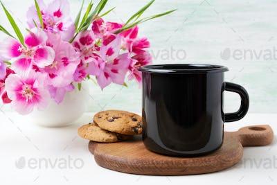Placeit – Black campfire enamel mug mockup with pink clarkia flowers