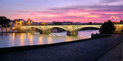 Triana Bridge In Seville Spain At Sunset