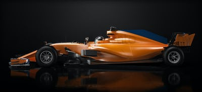 Orange race car side perspective