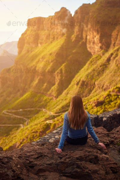 Young woman contemplating the road to Masca in Tenerife, Canary Islands, Spain
