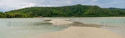 Sandy Bank in front of Local Village on Monsuar Island. Raja Ampat, Indonesia, West Papua