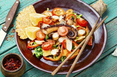 Vegetable salad with octopus.