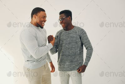 Handsome black men standing on a white background
